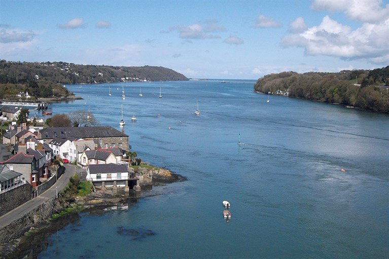 A tranquil view of the Menai Strait from Menai Bridge
