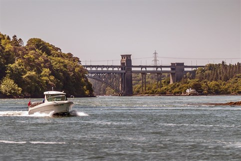 On the Menai Straits between the two bridges in the area known as 'The Swillies'